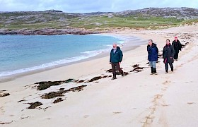 Guests walking on Taransay beach
