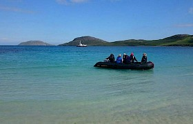 Guests coming ashore Vatersay beach