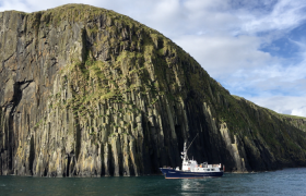 Elizabeth G anchored under the cliffs of the Shiant Isles