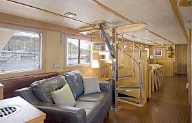 Deck saloon with stairs to wheelhouse