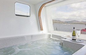 The hot tub with access to the lower aft deck
