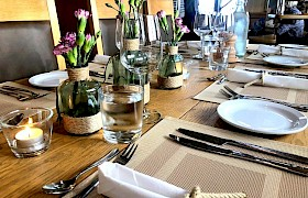 Place setting with hand made rope napkin rings and decorated vases by Emma. Photo James Fairbairns