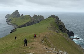 Guests on Hirta with Dun in the background. Photo Chris Gomersall