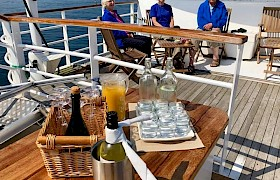 drinks on deck in the sunshine