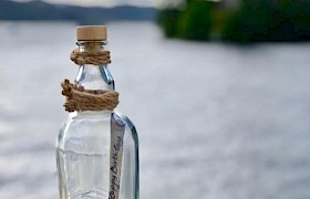 Message in a bottle cruising Loch Urquart on Loch Ness
